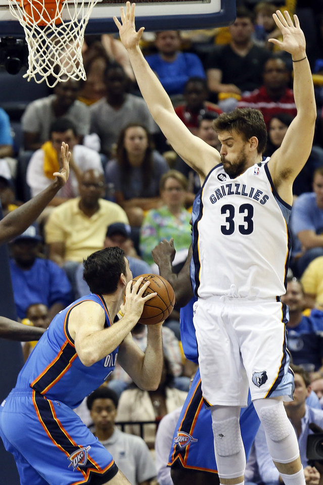 Photo - Memphis' Marc Gasol (33) defends Oklahoma City's Nick Collison (4) during Game 3 in the second round of the NBA basketball playoffs between the Oklahoma City Thunder and Memphis Grizzles at the FedExForum in Memphis, Tenn.,  Saturday, May 11, 2013. Memphis won, 87-81. Photo by Nate Billings, The Oklahoman
