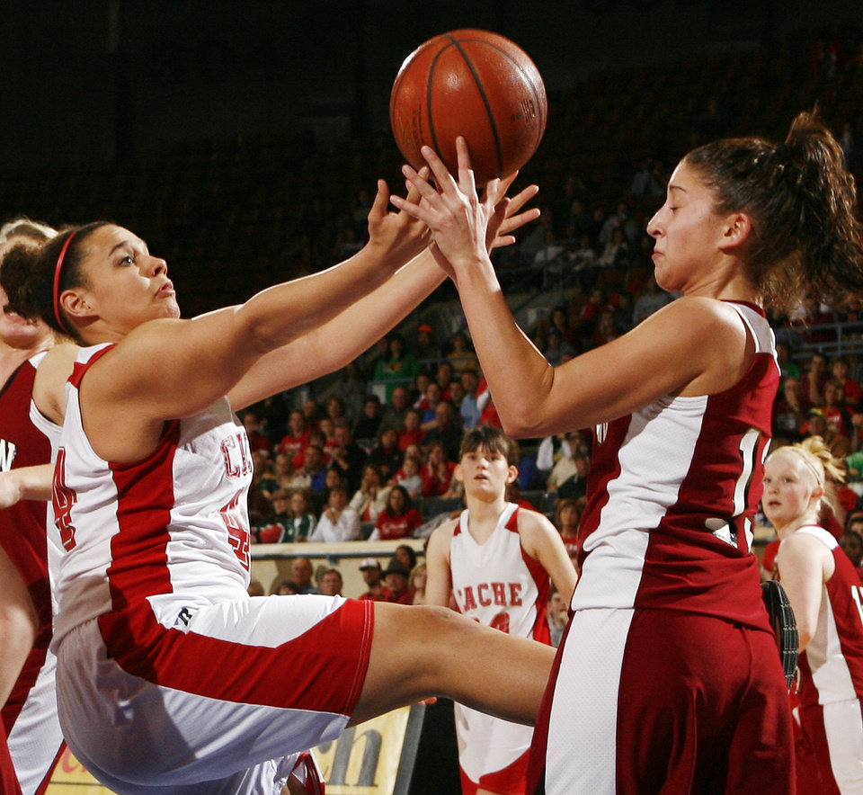 Photo - Cache's Honor Duvall (44), left, and Teala Cormier (13) of Muldrow try to grab a rebound during 4A girls semifinal game between Muldrow and Cache in the Oklahoma High School Basketball Championships at State Fair Arena in Oklahoma City, Friday, March 13, 2009. Cache won to advance to the championship game. PHOTO BY NATE BILLINGS, THE OKLAHOMAN