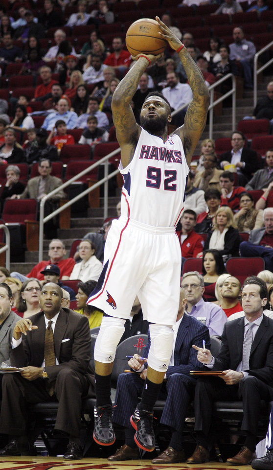 Atlanta Hawks guard DeShawn Stevenson (92) shoots a 3-pointer from the baseline against the Houston Rockets during the first half of an NBA basketball game, Monday, Dec. 31, 2012, in Houston. (AP Photo/Bob Levey)
