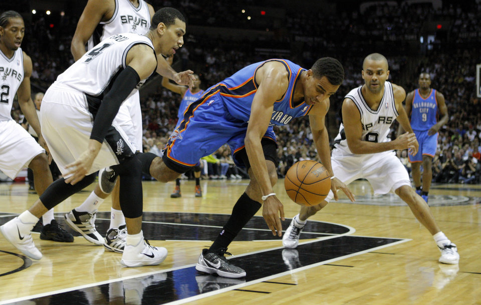 Photo - Oklahoma City's Thabo Sefolosha (2) goes for the ball between San Antonio's Daniel Green (4) and Tony Parker (9) during Game 2 of the Western Conference Finals between the Oklahoma City Thunder and the San Antonio Spurs in the NBA playoffs at the AT&T Center in San Antonio, Texas, Tuesday, May 29, 2012. Photo by Bryan Terry, The Oklahoman
