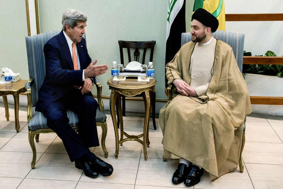 Photo - U.S. Secretary of State John Kerry, left, speaks with Sayyed Amar Al-Hakim, head of Supreme Islamic Council, during a meeting in Baghdad, Monday, June 23, 2014. Kerry flew to Baghdad on Monday to meet with Iraq's leaders and personally urge the Shiite-led government to give more power to political opponents before a Sunni insurgency seizes more control across the country and sweeps away hopes for lasting peace. (AP Photo/Brendan Smialowski, Pool)