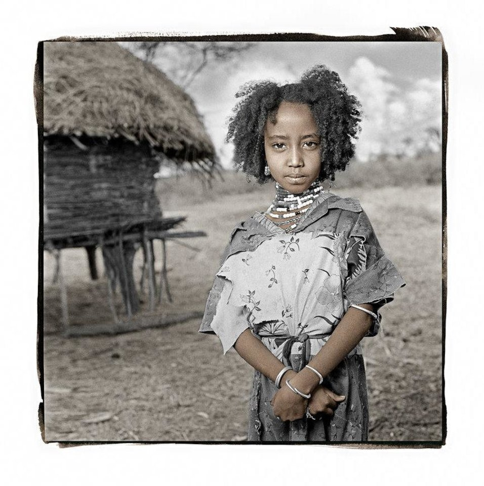 A portrait by Seattle-based photographer Phil Borges shows Rufo, a 7-year-old Ethiopian girl. Borges' portraits will be displayed as a part of the annual Puterbaugh Festival at the University of Oklahoma.  Photo provided