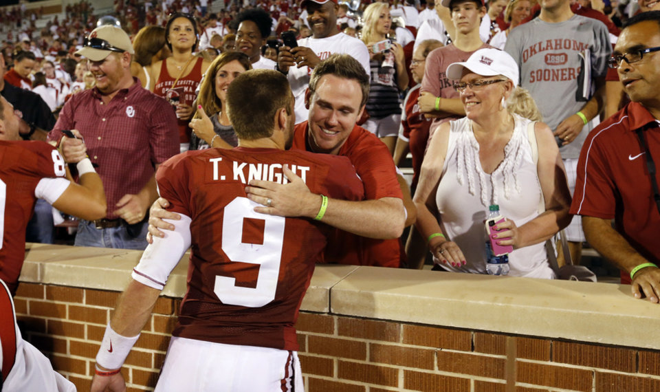 Photo - Oklahoma's Trevor Knight (9) gets hugs from family following the college football game where the University of Oklahoma Sooners (OU) play the University of Louisiana Monroe Warhawks at Gaylord Family-Oklahoma Memorial Stadium in Norman, Okla., on Saturday, Aug. 31, 2013. Photo by Steve Sisney, The Oklahoman