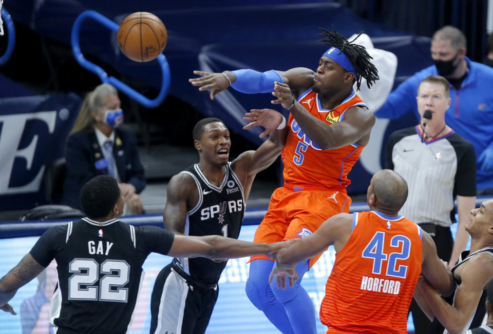 Photo - Oklahoma City's Luguentz Dort (5) passes the ball as San Antonio's Rudy Gay (22) and Lonnie Walker IV (1) defend during an NBA basketball game between the Oklahoma City Thunder and the San Antonio Spurs at Chesapeake Energy Arena in Oklahoma City, Tuesday, Jan. 12, 2021. [Bryan Terry/The Oklahoman]