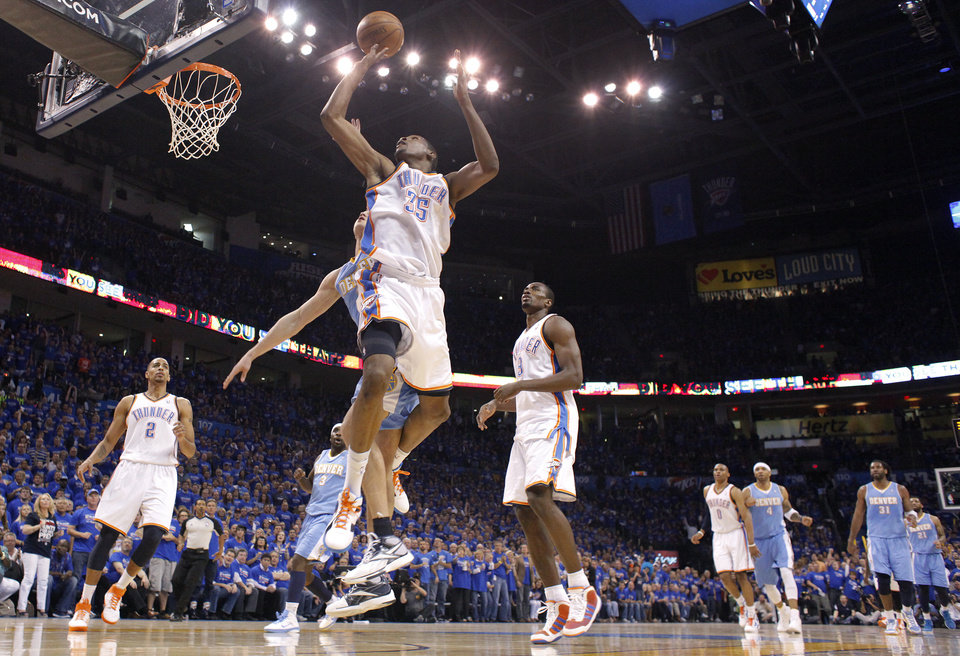 Photo - Oklahoma City's Kevin Durant (35) drives to the basket during the first round NBA playoff game between the Oklahoma City Thunder and the Denver Nuggets on Sunday, April 17, 2011, in Oklahoma City, Okla. Photo by Chris Landsberger, The Oklahoman