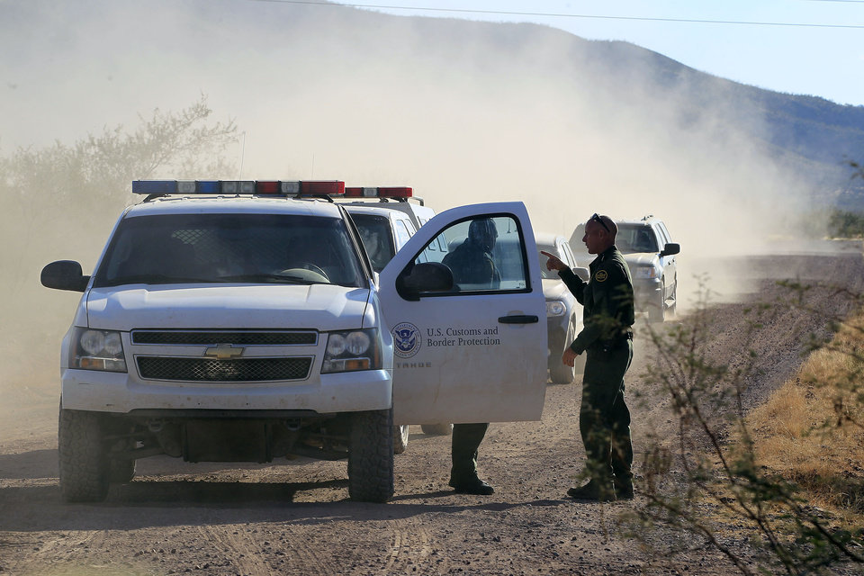 U.S. Customs and Border Protection officers and other law enforcement drive the roads near where U.S. Border Patrol agent Nicholas Ivie was shot and killed, and one other was shot and injured, Tuesday, Oct. 2, 2012, in Bisbee, Ariz. (AP Photo/Ross D. Franklin)