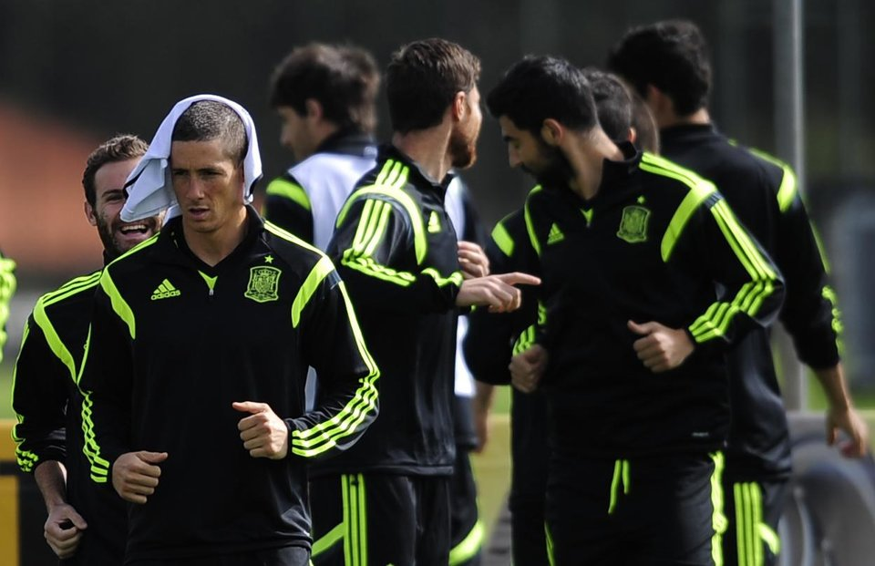 Photo - Spain's Fernando Torres, left, attends an official training session the day before the group B World Cup soccer match between Spain and Australia at the Atletico Paranaense training center in Curitiba, Brazil, Sunday, June 22, 2014. Spain will play in group B of the Brazil 2014 World Cup. (AP Photo/Manu Fernandez)