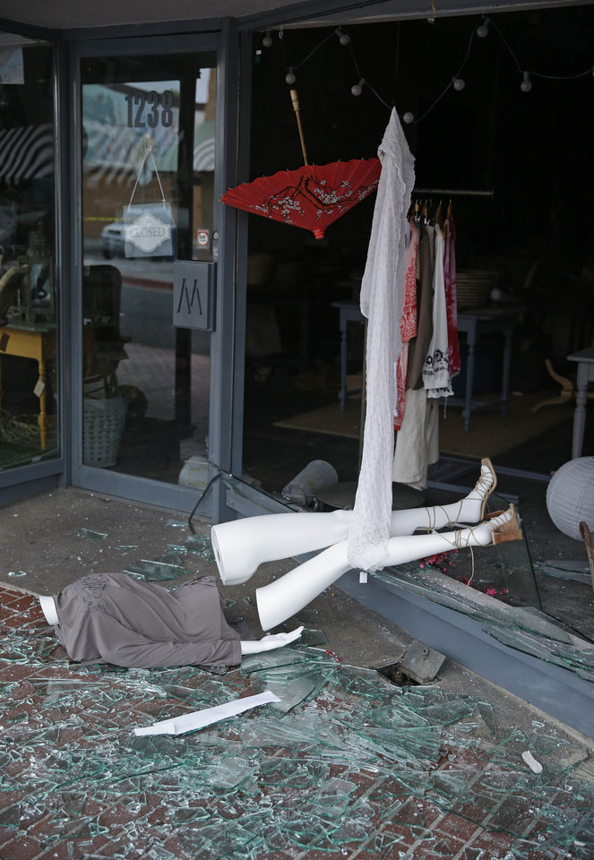 Photo - A broken mannequin and storefront window are on First Street following an earthquake Sunday, Aug. 24, 2014, in Napa, Calif. A large earthquake rolled through California's northern Bay Area early Sunday, damaging some buildings, igniting fires, knocking out power to tens of thousands and sending residents running out of their homes in the darkness. (AP Photo/Eric Risberg)