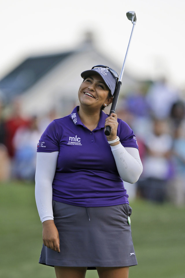 Photo - Lizette Salas reacts to a missed birdie putt on the 18th green during the third round of the Kingsmill Championship golf tournament in Williamsburg, Va., Saturday, May 17, 2014. Salas shot a 6-under 65 to take the lead at 13 under. (AP Photo/Steve Helber)
