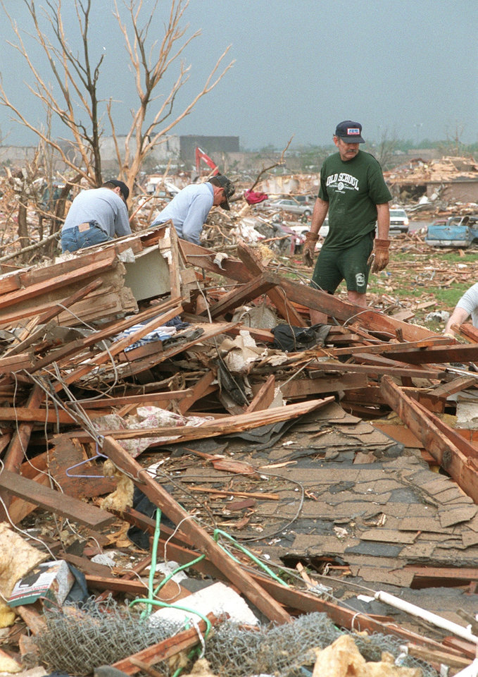 MAY 3, 1999 TORNADO: Jack Jones looks over tornado damage in Moore off Western and 12th street.  Westmoore High School is in the background.
