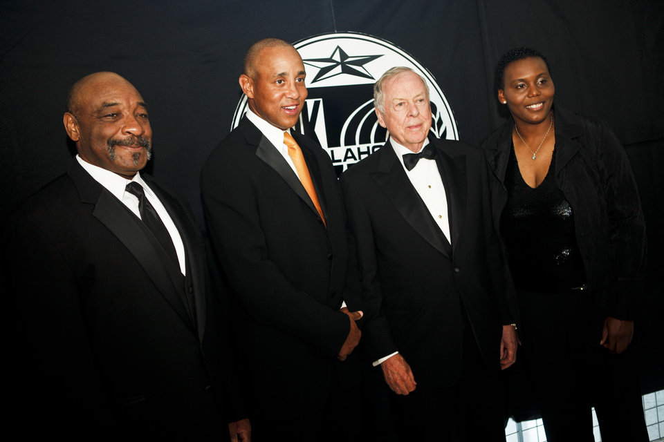 2011 Oklahoma Sports Hall of Fame inductees Lucious Selmon, John Starks, Boone Pickens and Crystal Robinson pose for a photo at the Jim Thorpe Association and Oklahoma Sports Hall of Fame Museum on Tuesday, Aug. 16, 2011. Photo by Zach Gray, The Oklahoman ORG XMIT: KOD