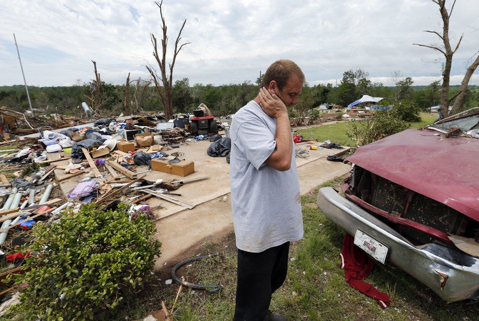 Photo - Terry DeSpain stands in front of the garage of his home which was obliterated by Sunday's tornado in the Woodlands and Pecan Valley area on Thursday, May 23, 2013 in Little Axe, Okla.  Photo by Steve Sisney, The Oklahoman