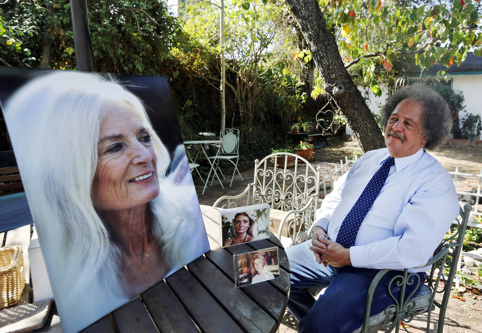 Photo - ADVANCE FOR USE SUNDAY, MAY 11, 2014 AND THEREAFTER - In this Wednesday, Feb. 19, 2014 photo, Jay Westbrook, clinical director of Compassionate Journey, sits next to photos of his late wife, Nancy, in their backyard in Los Angeles. There have been thousands of souls he journeyed with to the intersection of living and dying, who helped establish him as one of the foremost experts on hospice care. Then came one death too many - when his beloved Nancy died. (AP Photo/Damian Dovarganes)