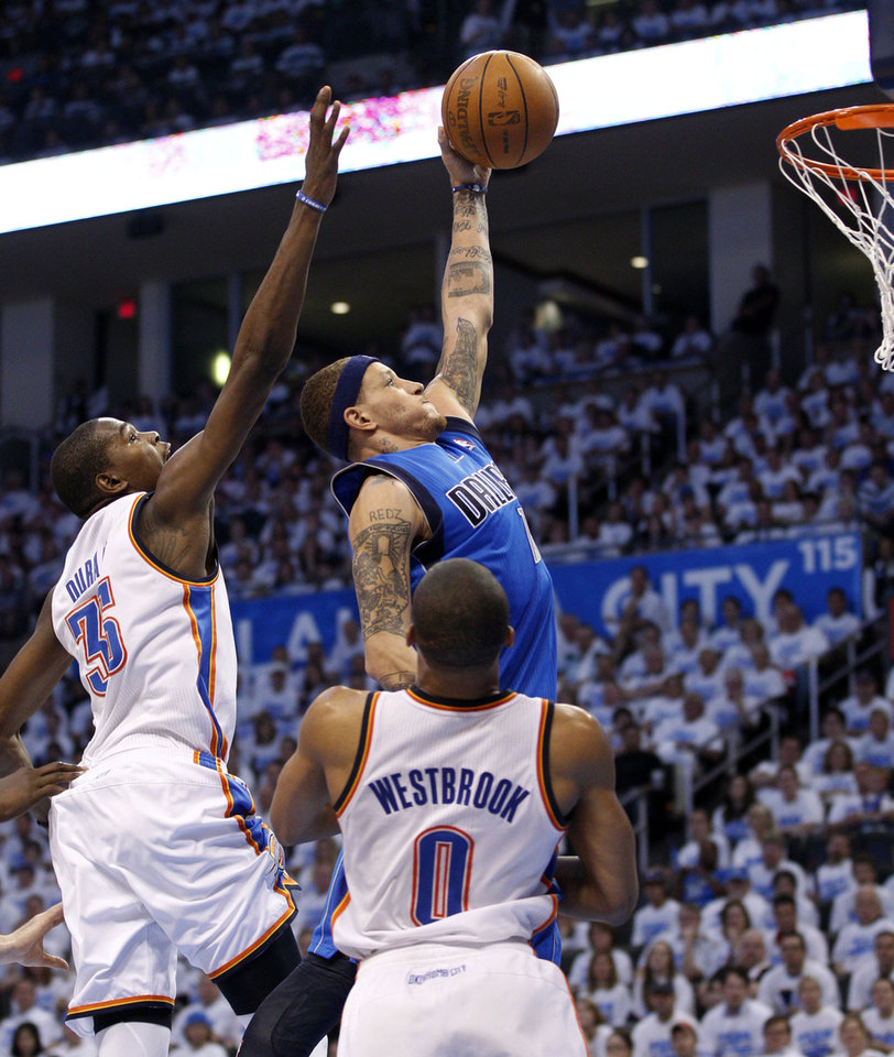 Photo -   Dallas Mavericks guard Delonte West, right, shoots between Oklahoma City Thunder forward Kevin Durant (35) and guard Russell Westbrook (0) in the third quarter of Game 2 in the first round of the NBA basketball playoffs, in Oklahoma City, Monday, April 30, 2012. Oklahoma City won 102-99. (AP Photo/Sue Ogrocki)