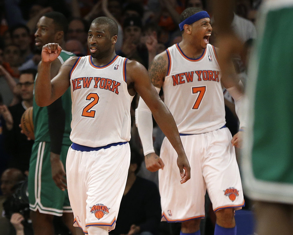 Photo - New York Knicks guard Raymond Felton (2) and forward Carmelo Anthony (7) celebrate in the fourth quarter of their 85-78 victory over the Boston Celtics in Game 1 of the NBA basketball playoffs in New York, Saturday, April 20, 2013. (AP Photo/Kathy Willens)