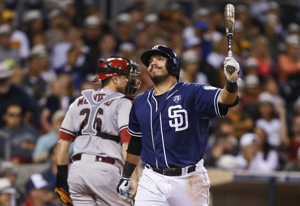Photo - San Diego Padres' Rene Rivera reacts after striking out with the bases loaded to end the sixth inning against the Arizona Diamondbacks in a baseball game Saturday, June 28, 2014, in San Diego. (AP Photo/Lenny Ignelzi)