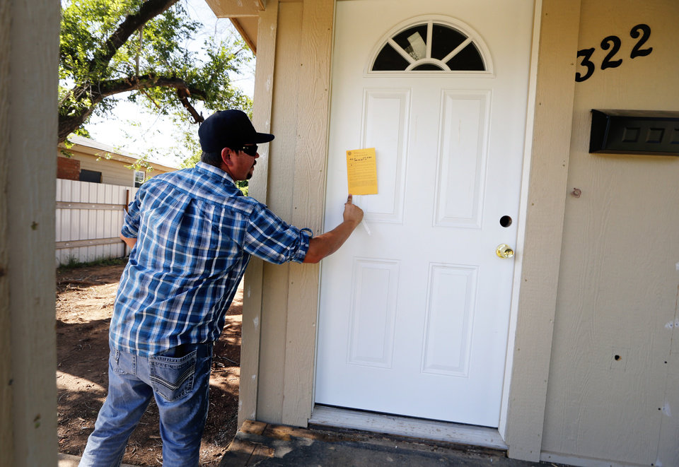 Photo -  Code enforcement officer Brandon Williams makes inspections and gives citations Tuesday in Oklahoma City. [Photo by Steve Sisney, The Oklahoman]