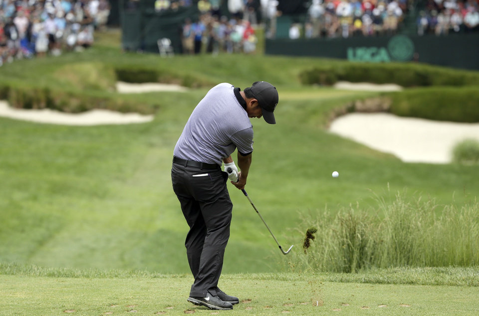 Photo - Cheng-Tsung Pan, of Taiwan, hits on the 13th hole during the first round of the U.S. Open golf tournament at Merion Golf Club, Thursday, June 13, 2013, in Ardmore, Pa. (AP Photo/Charlie Riedel)