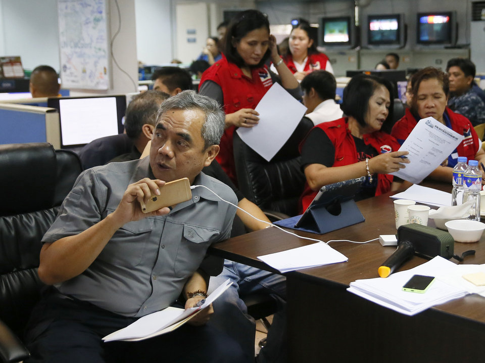 Photo - Undersecretary Alexander Pama, head of the country's National Disaster Risk Reduction Management Council, coordinates with the preparations on the approaching Typhoon Koppu Saturday, Oct. 17, 2015 at suburban Quezon city, northeast of Manila, Philippines. Typhoon Koppu, packing sustained winds of 160 kilometers (100 miles) per hour and gusts of up to 190 kph (119 mph) early Saturday about 300 kilometers (188 miles) east of Aurora province in northeastern Philippines, is forecast to make landfall early Sunday. Disaster officials advised communities in flood-prone areas of the northern Philippines to evacuate Saturday as the slow-moving typhoon bore down on the coast with heavy rains and high winds. (AP Photo/Bullit Marquez)
