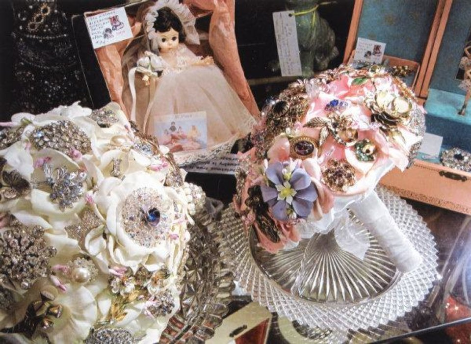Photo - Donna Matts makes vintage brooch bouquets which she sells in her booth at Gatherings Antiques & Interiors, 5219 N Western Ave. Photo provided.  Prepress
