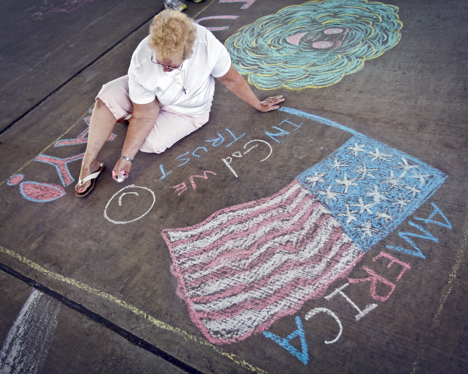 Becky Smith works on her art during the sidewalk chalk contest in Downtown Edmond on Friday, June 29, 2012, in Edmond, Oklahoma. Photo by Chris Landsberger, The Oklahoman