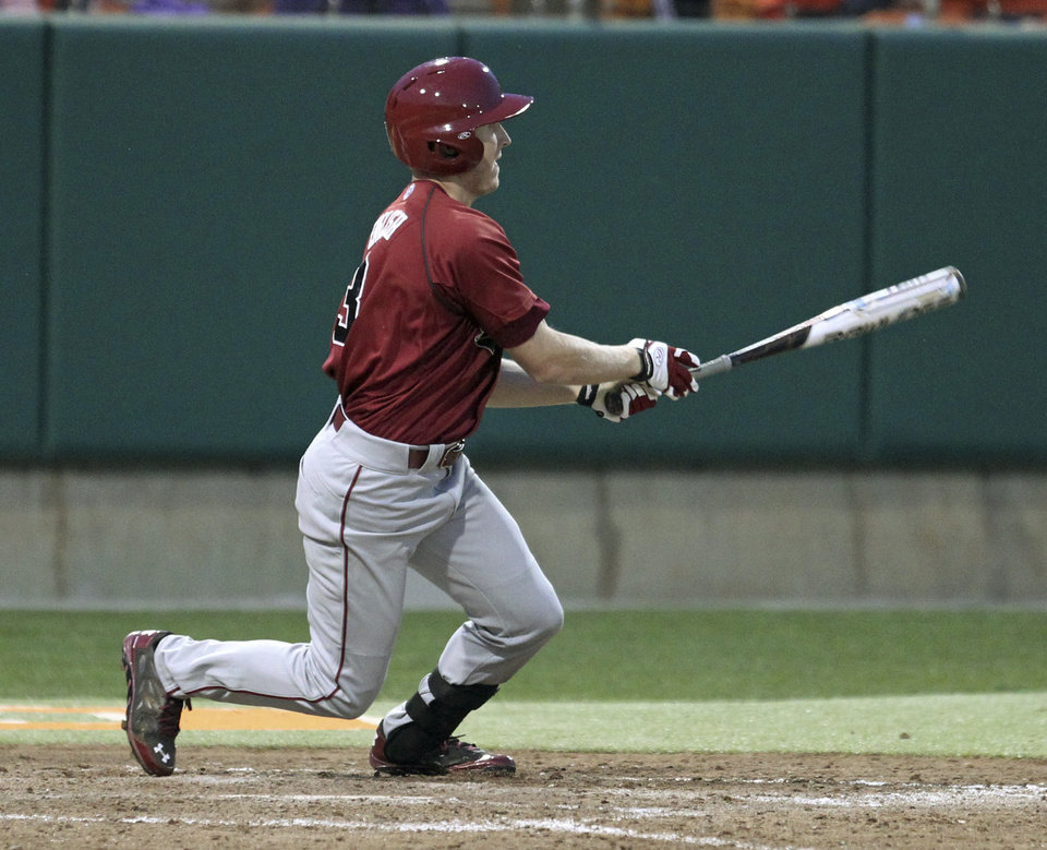 Photo - South Carolina's Tanner English watches his two-run double in the ninth inning that scored the winning runs to beat Clemson 5-3 in an NCAA college baseball game on Sunday, March 2, 2014 in Clemson, S.C. (AP Photo/Anderson Independent-Mail, Mark Crammer) GREENVILLE NEWS OUT  SENECA JOURNAL OUT