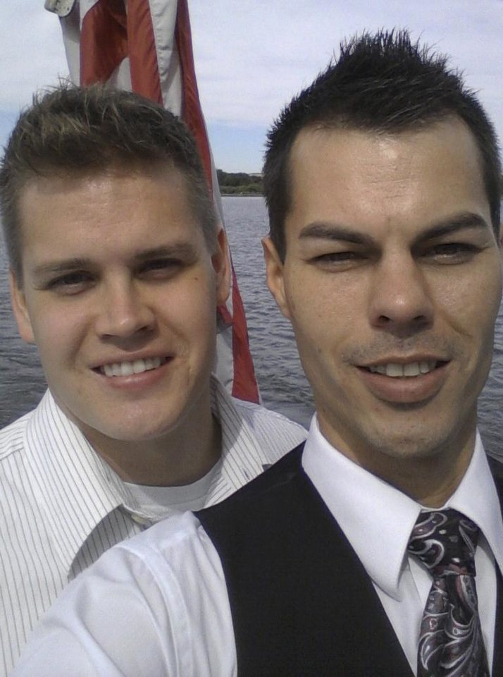 Photo - This Oct. 8, 2013, photo provided by Thomas Hafke shows Hafke, left, and his husband Chad Higby, while cruising on the Potomac River on their wedding day in Washington. Hafke, 30, went online in December and bought a family plan for his husband and himself from Blue Cross and Blue Shield of North Carolina. But the Chapel Hill-based company then canceled family coverage it sold to about 20 same-sex couples through the marketplace because of contract phrasing that defined