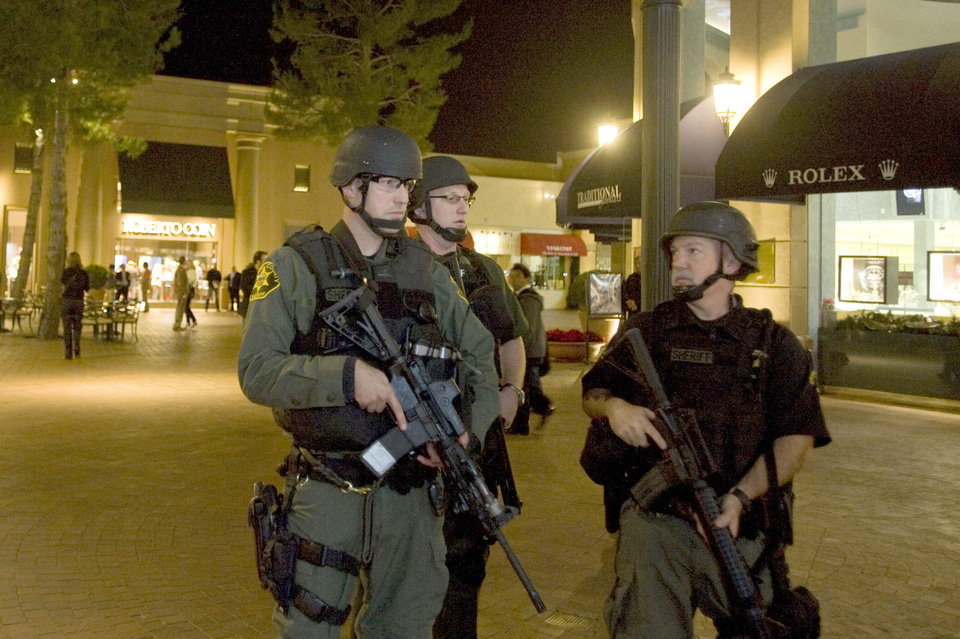 Photo - Orange County Sheriff deputies patrol after the Macy's Department store at Fashion Island  in Newport Beach went into lockdown Saturday, Dec. 15, 2012 after witnesses reported multiple shots being fired in one of the parking lots. (AP Photo/The Orange County Register, Rose Palmisano)   MAGS OUT; LOS ANGELES TIMES OUT