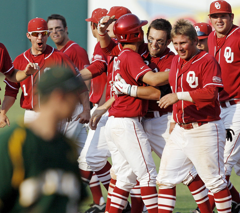 Photo - The OU Sooners celebrate with Evan Mistich (9), third from right, after Mistich hit a game-winning RBI single in the bottom of the ninth during a Big 12 Baseball Championship tournament game between the Oklahoma Sooners and Baylor Bears at the Chickasaw Bricktown Ballpark in Oklahoma City,Thursday, May 24, 2012. OU won, 3-2. Photo by Nate Billings, The Oklahoman