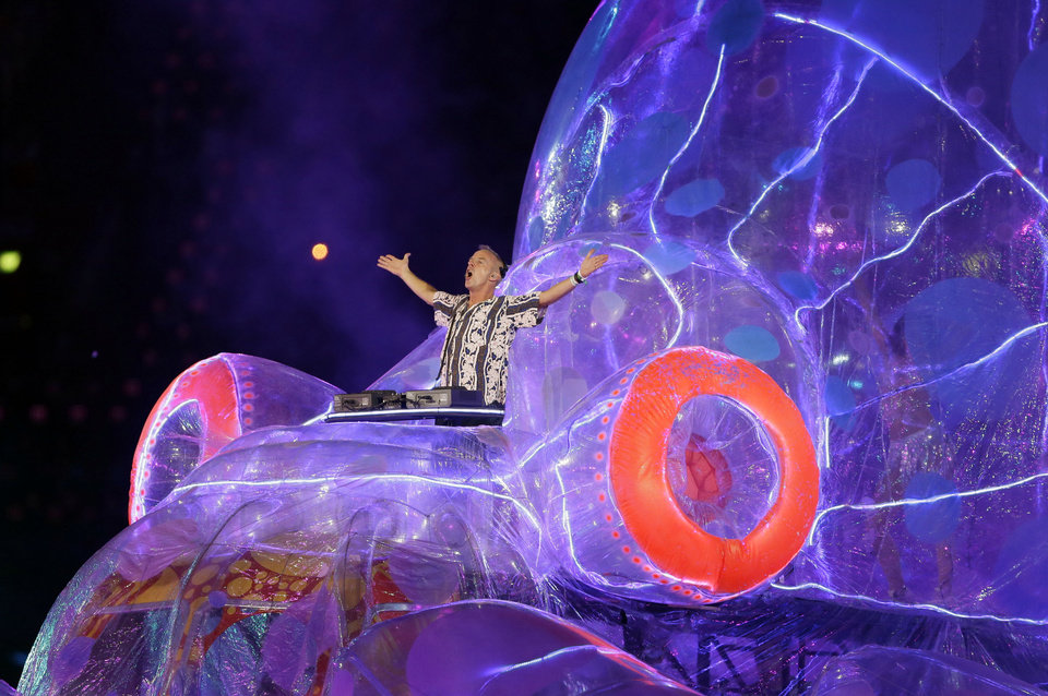 Photo -   Fatboy Slim performs during the Closing Ceremony at the 2012 Summer Olympics, Sunday, Aug. 12, 2012, in London. (AP Photo/Kristy Wigglesworth)
