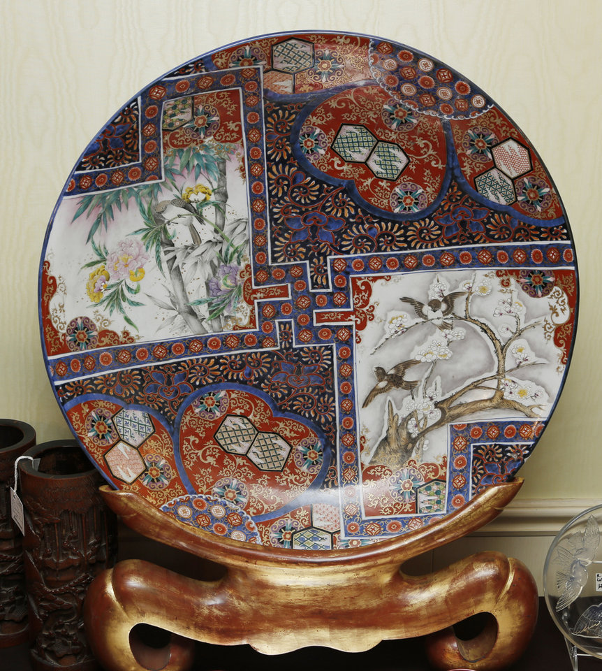 Photo -  An Imari painted plate is included in the estate of the late Lawrence E. Walsh, the Iran-Contra special prosecutor, and his wife, Mary Porter Walsh, who lived in Nichols Hills. Photo by Doug Hoke, The Oklahoman   DOUG HOKE -  THE OKLAHOMAN