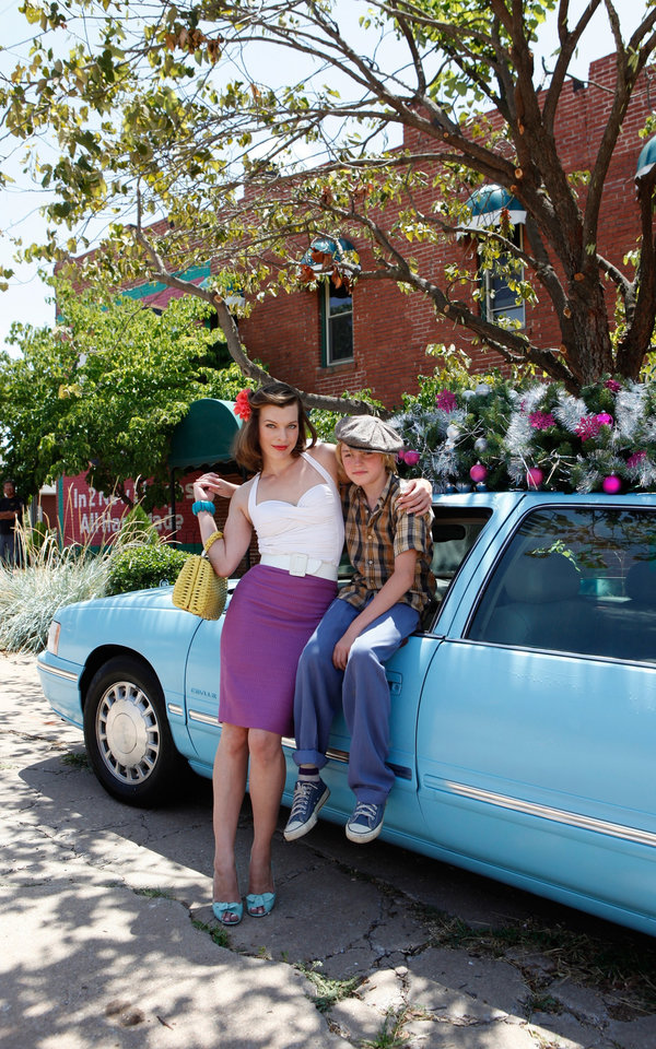Milla Jovovich as Olive, a nomadic European con artist trying to settle in Oklahoma, and Spencer List as her son Bobby, in the film