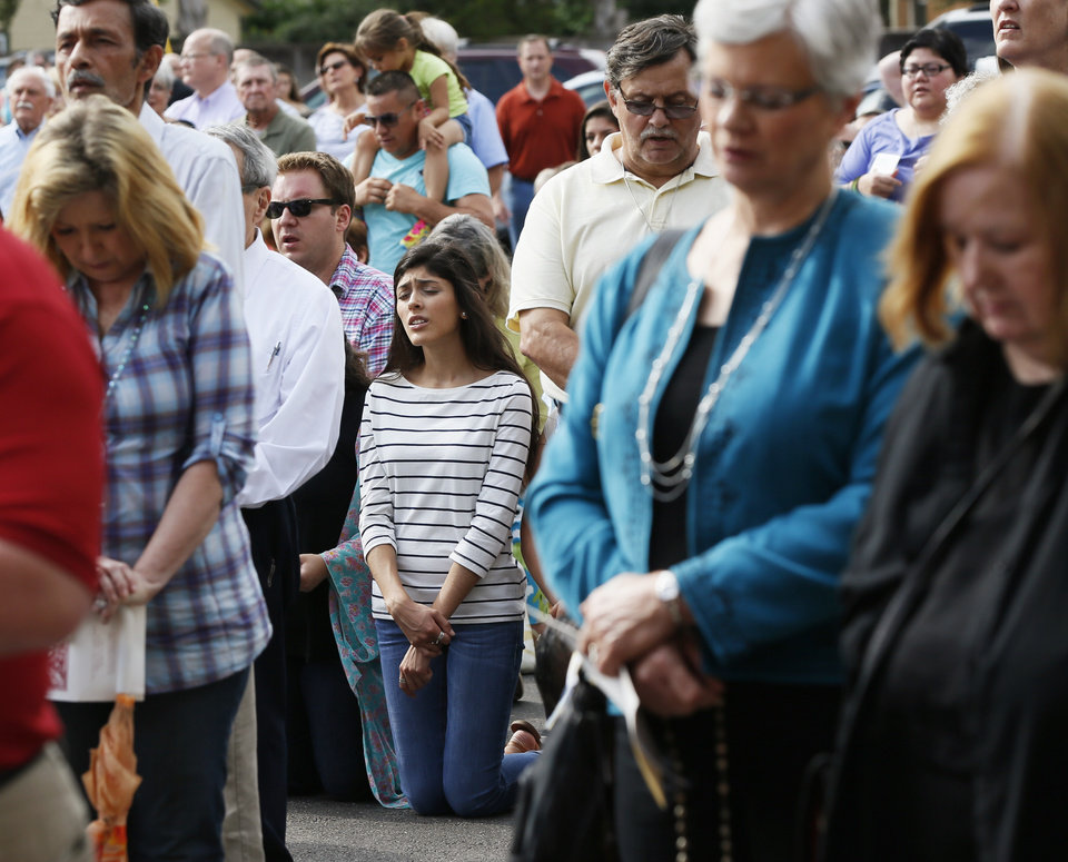 Photo - People pray Sunday outside during the Roman Catholic Archdiocese of Oklahoma City's Eucharistic Holy Hour at Saint Francis of Assisi Catholic Church.  Photo by Nate Billings, The Oklahoman  NATE BILLINGS - NATE BILLINGS