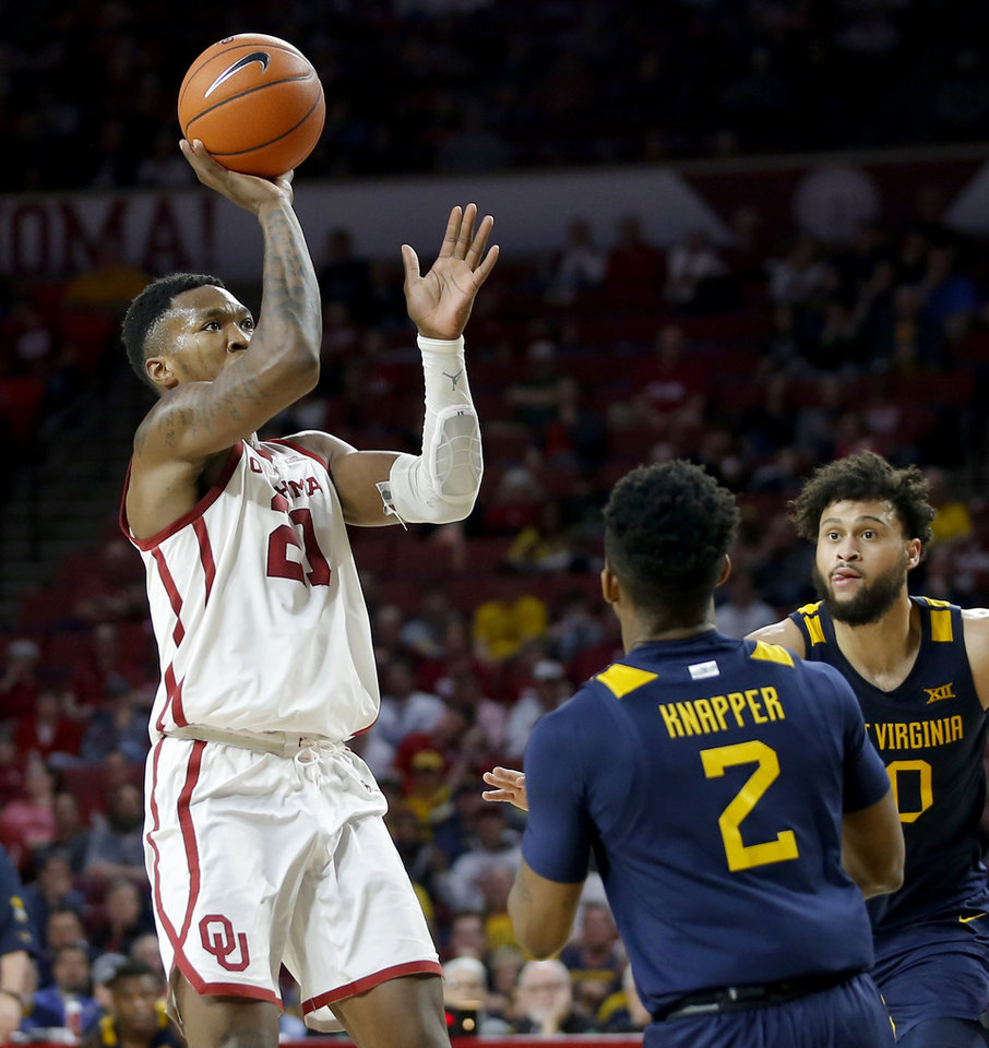 Photo - Oklahoma's Kristian Doolittle (21) shoots a basket ver West Virginia's Brandon Knapper (2) during an NCAA mens college basketball game between the University of Oklahoma Sooners (OU) and the West Virginia Mountaineers at the Lloyd Noble Center in Norman, Okla.,Saturday, Feb. 8, 2020. Oklahoma won 69-59. [Bryan Terry/The Oklahoman]