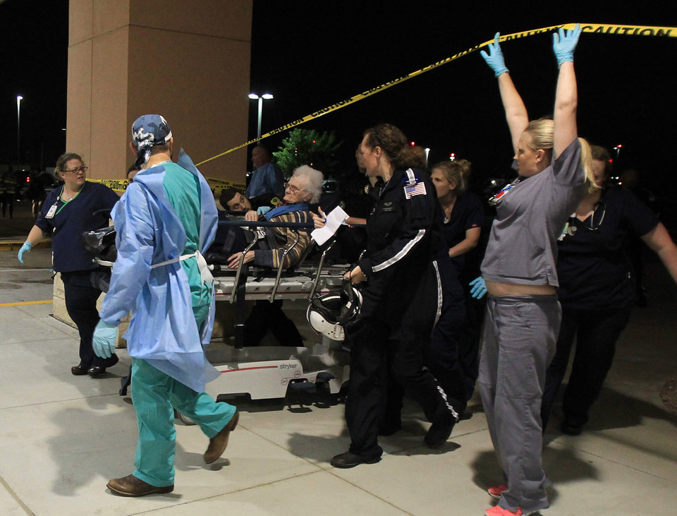Photo - A victim from the West fertilizer plant explosion is wheeled into Hillcrest Baptist Medical Hospital in Waco, Texas, Wednesday, April 17, 2013. (AP Photo/Waco Tribune Herald, Jerry Larson)