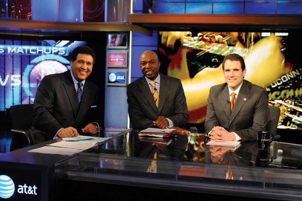 Greg Gumbel hosts March Madness for CBS and Turner Broadcasting. He is in shown with Greg Anthony and Seth Davis in 2009. Photo provided by CBS <strong>JEFFREY R STAAB</strong>