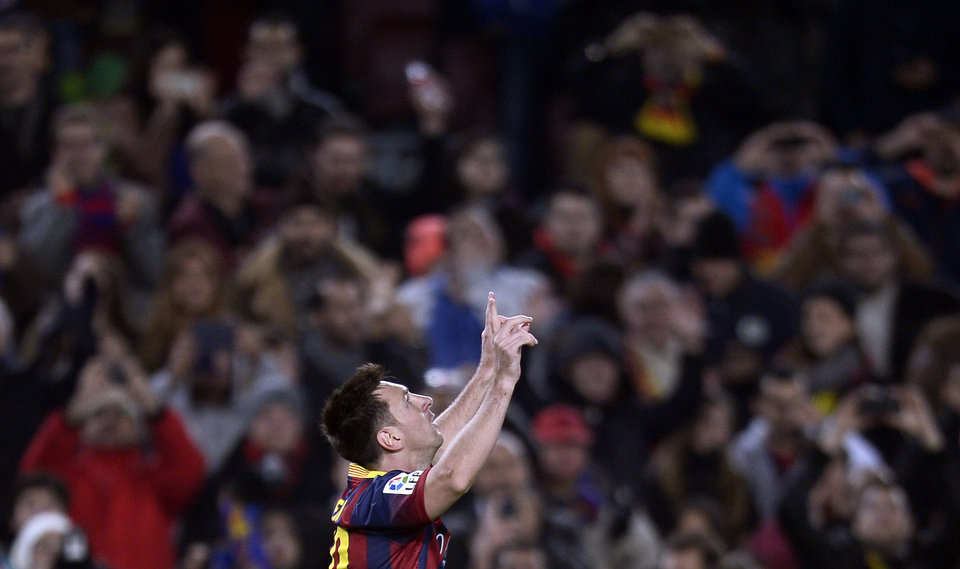 Photo - FC Barcelona's Lionel Messi, from Argentina, reacts after scoring against Getafe during a Copa del Rey soccer match at the Camp Nou stadium in Barcelona, Spain, Wednesday, Jan. 8, 2014. (AP Photo/Manu Fernandez)
