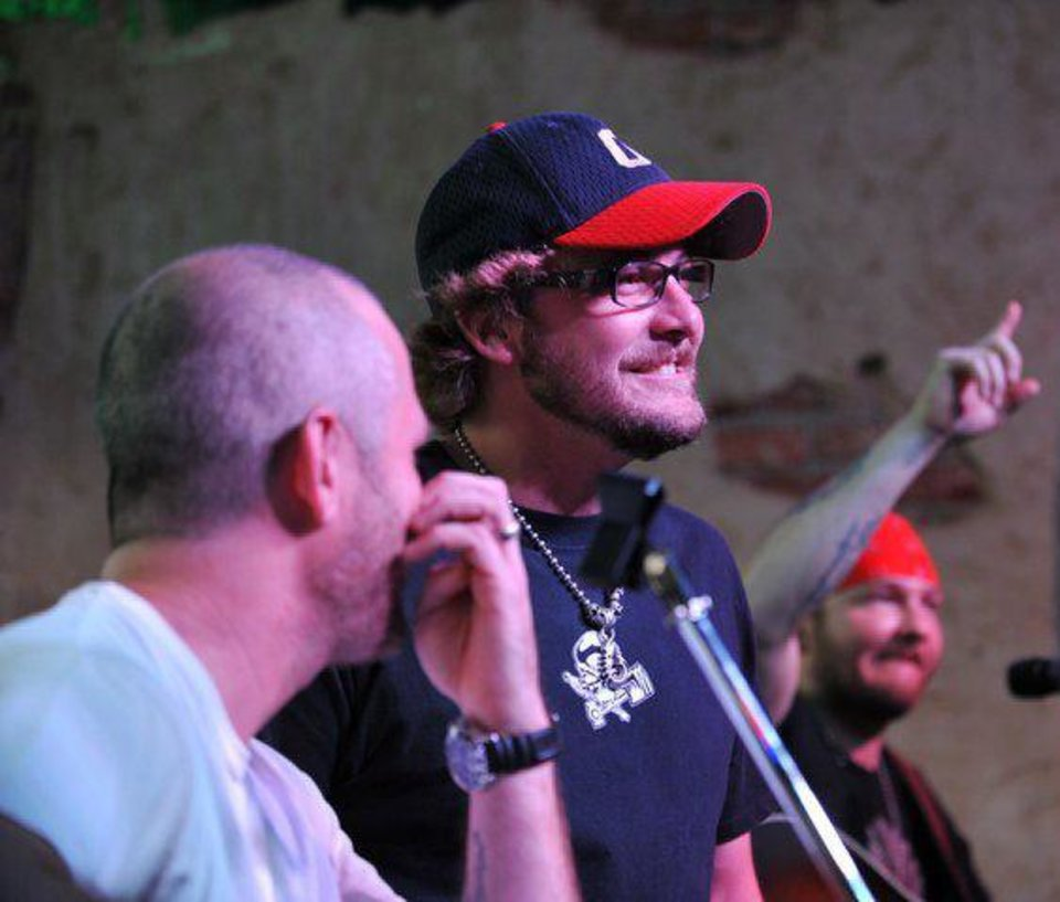 Photo - From left, Mike McClure, Grady Cross and Stoney LaRue appear on stage together during a performance at Grady's 66 Pub in Yukon. McClure and LaRue will play an acoustic song swap at a benefit show Sunday at the pub, which Cross owns. Photo provided by Goodger Photography.