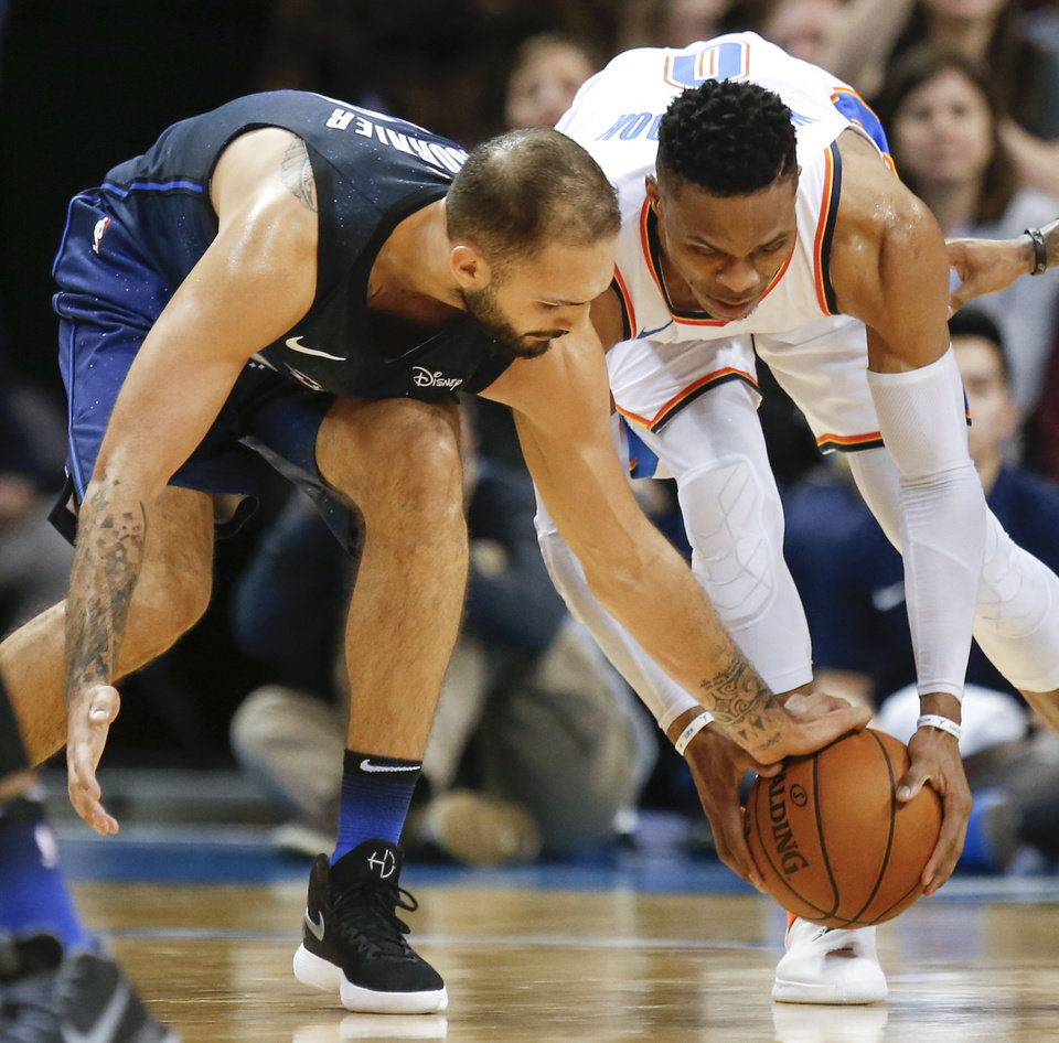 Photo - Orlando's Evan Fournier (10) tries to steal the ball from Oklahoma City's Russell Westbrook (0) during an NBA basketball game between the Oklahoma City Thunder and the Orlando Magic at Chesapeake Energy Arena in Oklahoma City, Monday, Feb. 26, 2018. Oklahoma City won 112-105. Photo by Nate Billings, The Oklahoman