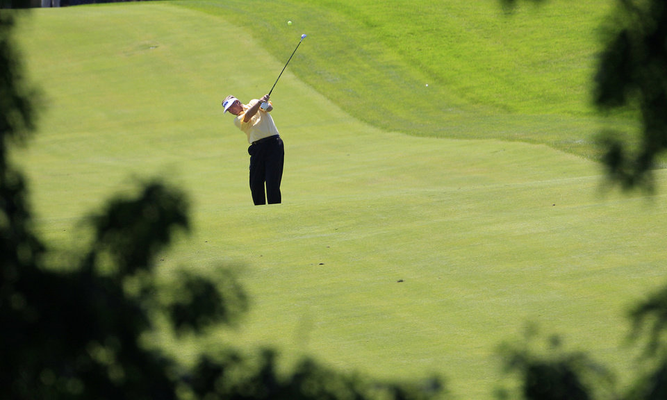 Photo -   Peter Jacobsen hits from the 15th fairway during the first round at the U.S. Senior Open golf tournament at the Indianwood Golf and Country Club in Lake Orion, Mich., Thursday, July 12, 2012. (AP Photo/Carlos Osorio)