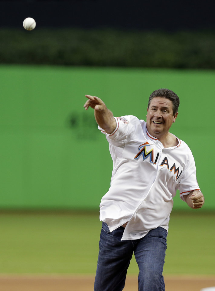 Photo - Former Miami Dolphins quarterback Dan Marino throws out the ceremonial first pitch before an opening day baseball game between the Miami Marlins and Colorado Rockies, Monday, March 31, 2014, in Miami. (AP Photo/Lynne Sladky)