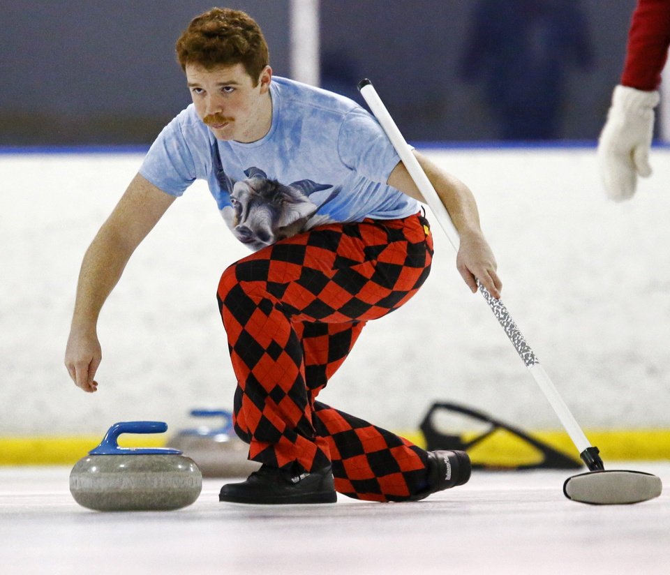 Jason Troy delivers a stone while curling with the Oklahoma Curling Club at the Arctic Edge Ice Arena in Edmond, Okla., Sunday, Jan. 26, 2014. Photo by Nate Billings, The Oklahoman