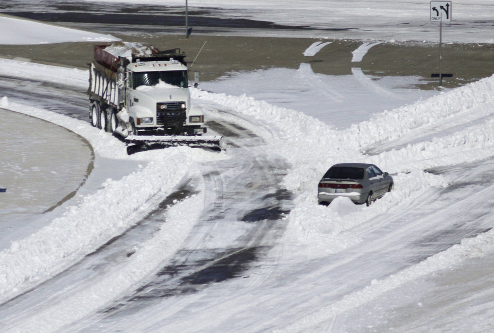 Photo - A snow plow clears the roadway during cleanup Wednesday, Feb. 2, 2011 of a major winter storm that hit central Oklahoma Tuesday . Photo by Doug Hoke, The Oklahoman.