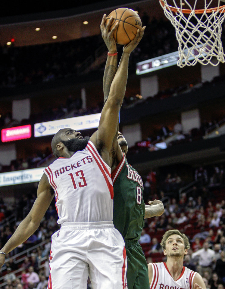 Houston Rockets guard James Harden (13) is blocked by Milwaukee Bucks center Larry Sanders (8) during the second half of an NBA basketball game, Wednesday, Feb. 27, 2013 in Houston. Milwaukee won 110-107. (AP Photo/Bob Levey)