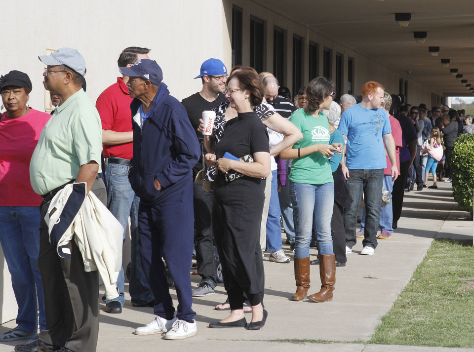 Photo - Oklahoma County voters turn out in large numbers Friday, Nov. 2, 2012, as early voting begins at the Oklahoma County Election Board in Oklahoma City, OK. By Paul Hellstern, The Oklahoman  PAUL HELLSTERN - Oklahoman