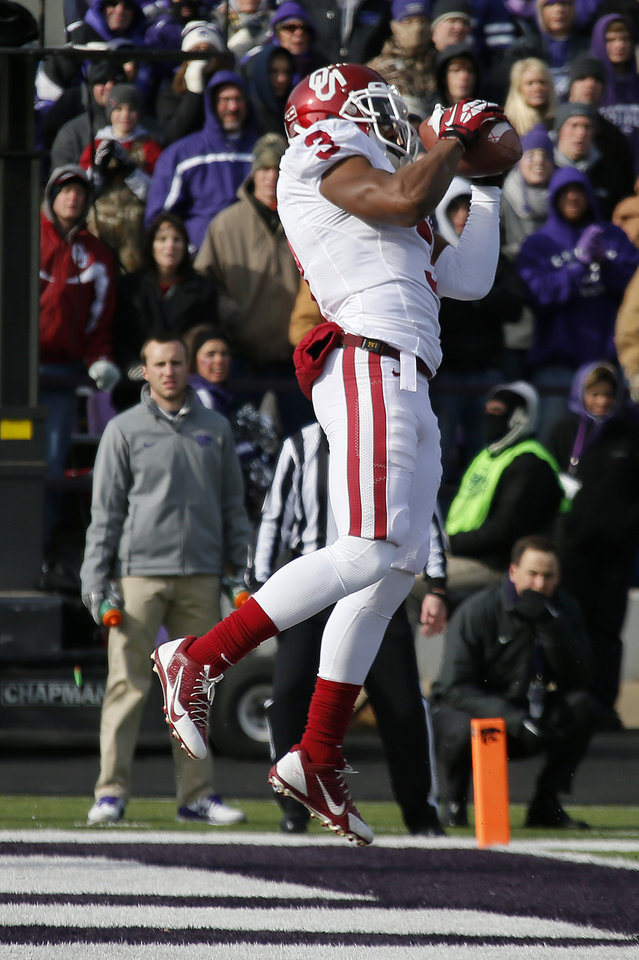 Oklahoma's Sterling Shepard (3) catches a touchdown pass during an NCAA college football game between the Oklahoma Sooners and the Kansas State University Wildcats at Bill Snyder Family Stadium in Manhattan, Kan., Saturday, Nov. 23, 2013. Photo by Bryan Terry, The Oklahoman