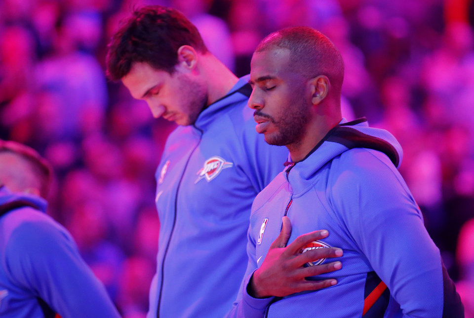 Photo - Oklahoma City's Chris Paul (3) stands for the national anthem before the NBA basketball game between the Oklahoma City Thunder and the Sacramento Kings at the Chesapeake Energy arena in Oklahoma City,  Thursday, Feb. 27, 2020.  [Sarah Phipps/The Oklahoman]