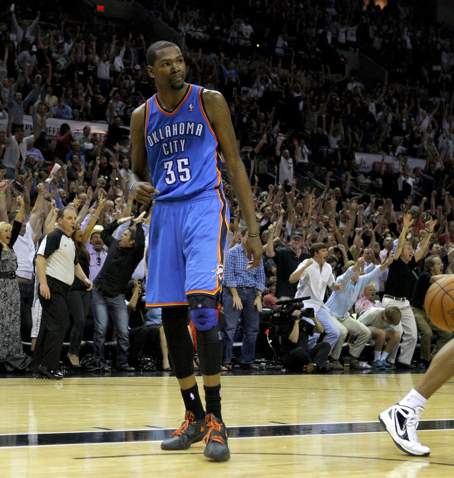 Photo - The crowd reacts after a San Antonio basket as Oklahoma City's Kevin Durant (35) waits for the ball during Game 2 of the Western Conference Finals between the Oklahoma City Thunder and the San Antonio Spurs in the NBA playoffs at the AT&T Center in San Antonio, Texas, Tuesday, May 29, 2012. Oklahoma City lost 120-111. Photo by Bryan Terry, The Oklahoman