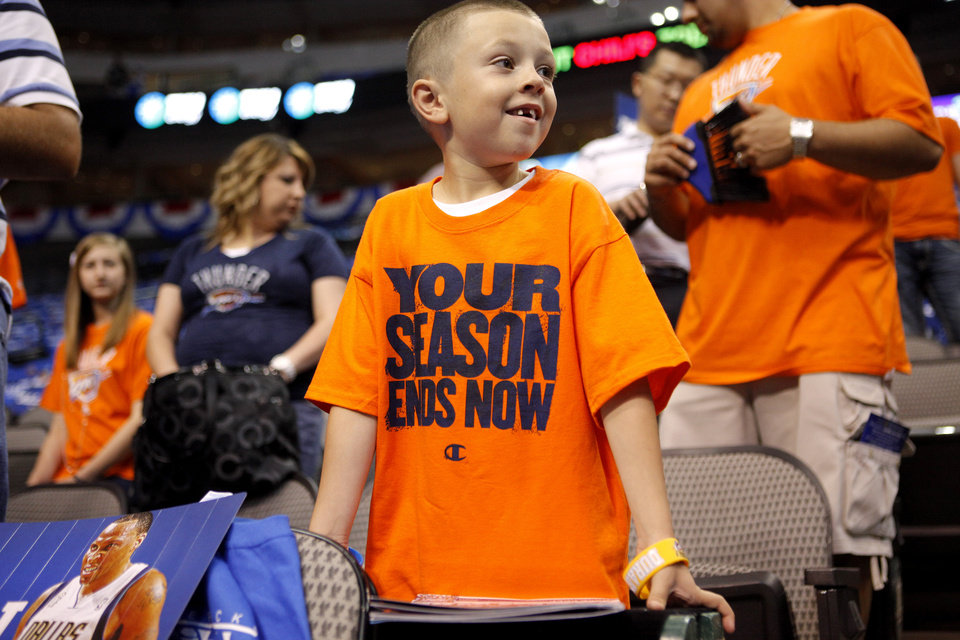 Ethan Holliday, 6, of Yukon waits for the start of Game 4 during the first round in the NBA playoffs between the Oklahoma City Thunder and the Dallas Mavericks at American Airlines Center in Dallas, Saturday, May 5, 2012. Photo by Bryan Terry, The Oklahoman