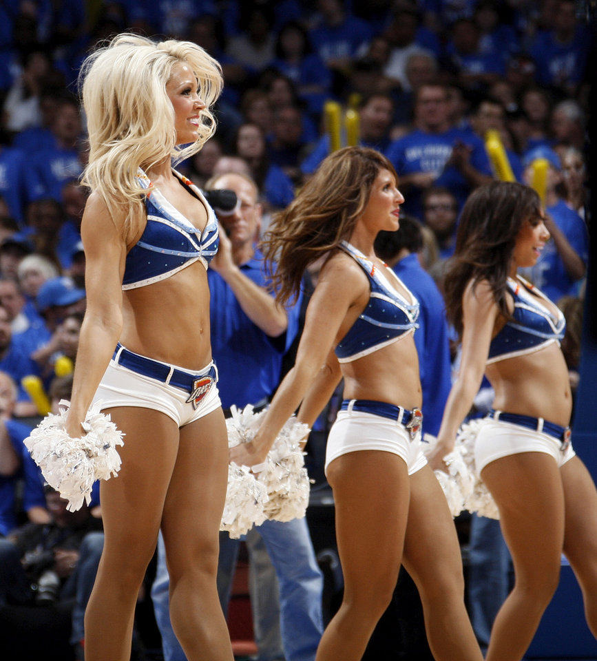 The Thunder Girls dance team perform during game one of the first round in the NBA playoffs between the Oklahoma City Thunder and the Dallas Mavericks at Chesapeake Energy Arena in Oklahoma City, Saturday, April 28, 2012. Oklahoma City won, 99-98. Photo by Nate Billings, The Oklahoman
